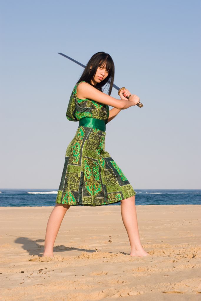 Beautiful Asian woman with japanese sword-katana in black dress by the sea Ⅲ.(海辺で日本刀を構える黒いワンピース姿の美しいアジア人女性 其の三)