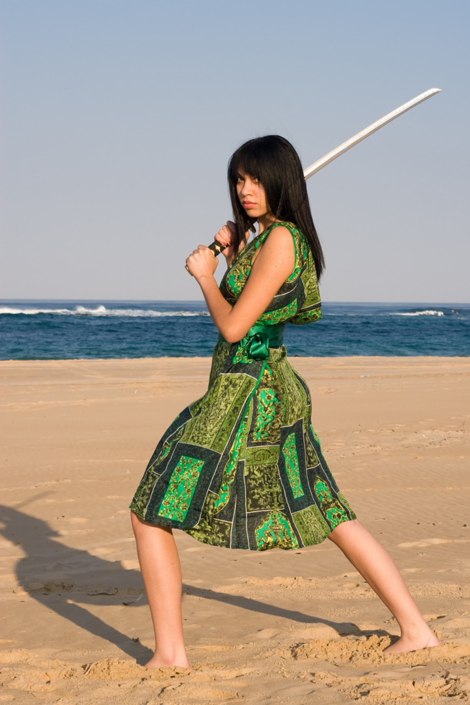 Beautiful Asian woman with japanese sword-katana in green dress by the sea Ⅰ.(海辺で日本刀を構える緑のワンピース姿の美しいアジア人女性 其の一)