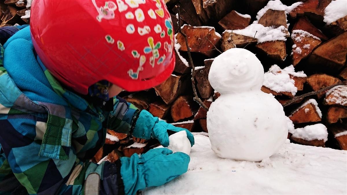 雪だるまと子供