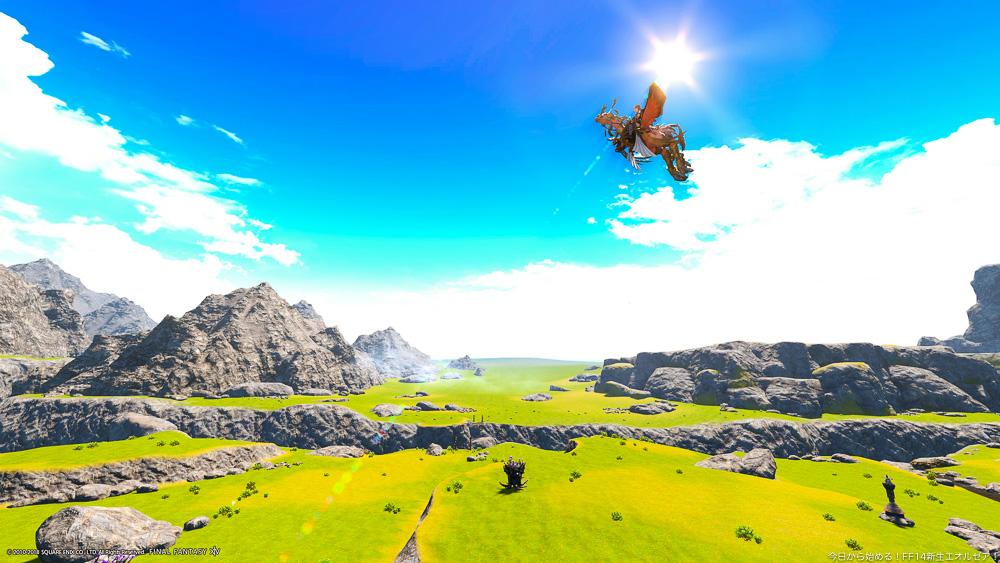 アジムステップの草原を空から撮影したスクリーンショット。青空と草原が壮大で美しい。(FF14)