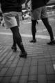 岡山市北区駅元町の風景写真 - Two persons of a sidewalk