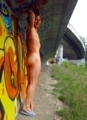 Enjoying to be seen nude under a bridge