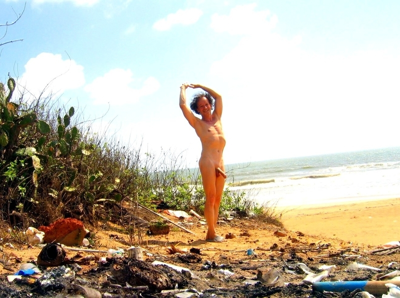 Enjoying exhibitionism nude and shaved on a beach