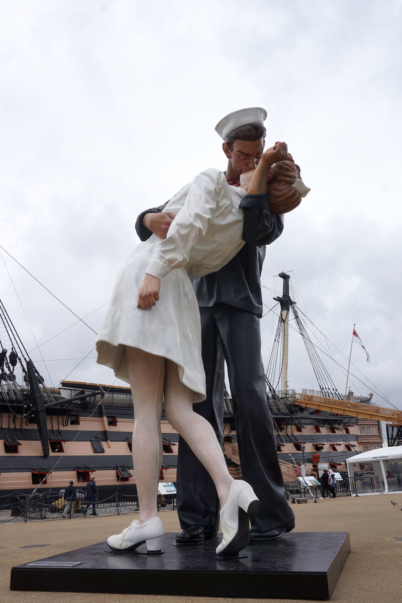 statue in front of HMS Victory