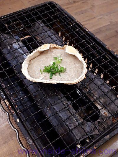 磯丸水産、蟹味噌甲羅焼(税込539円)