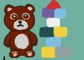 ぬいぐるみのクマと積み木