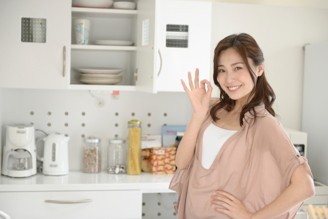 a-woman-standing-kitchen