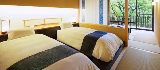 界 鬼怒川 客室のベッド