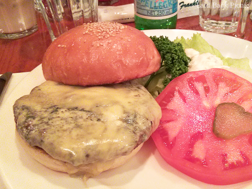 Cheese on hamburger and big tomato