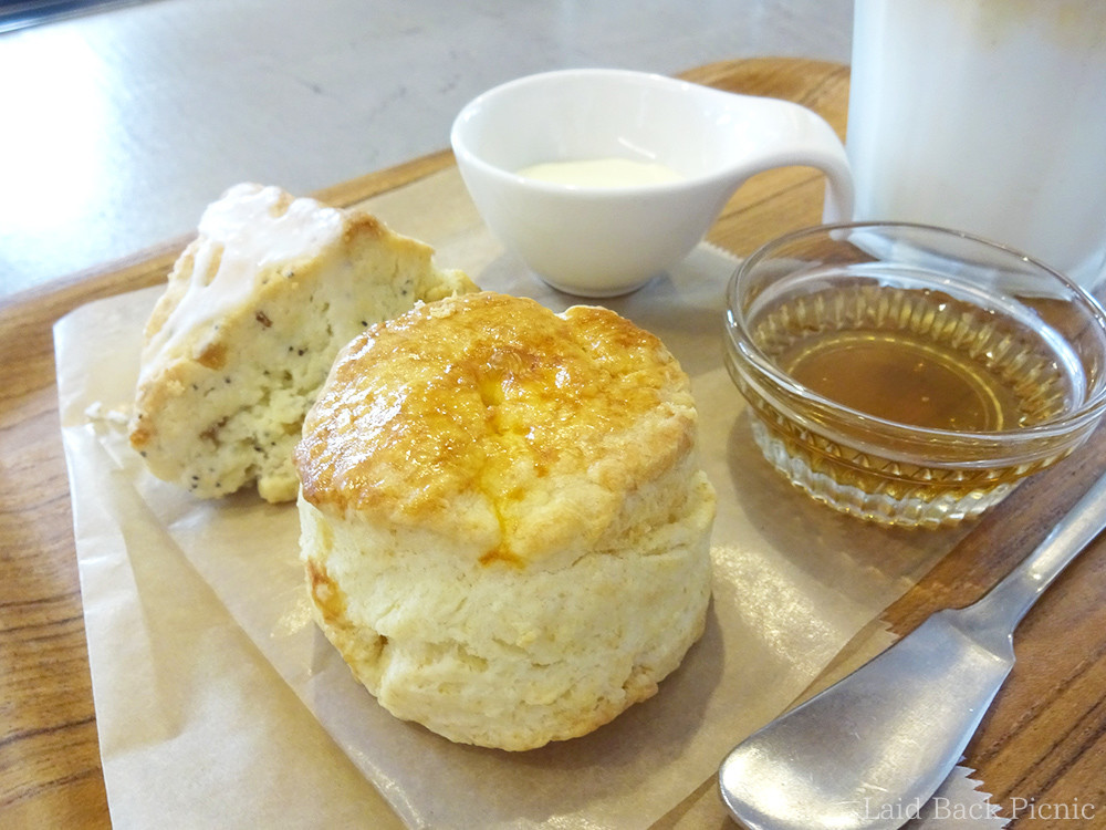 Plain scone is round, lemon poppy seed scone is triangular