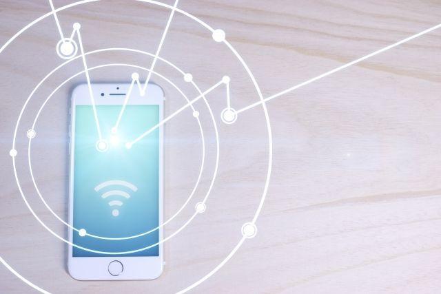 携帯電話から広がるネットワークのイメージ