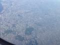 東京上空。国立競技場や代々木公園が見える