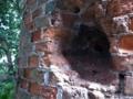 弾痕のある製糖所煙突跡