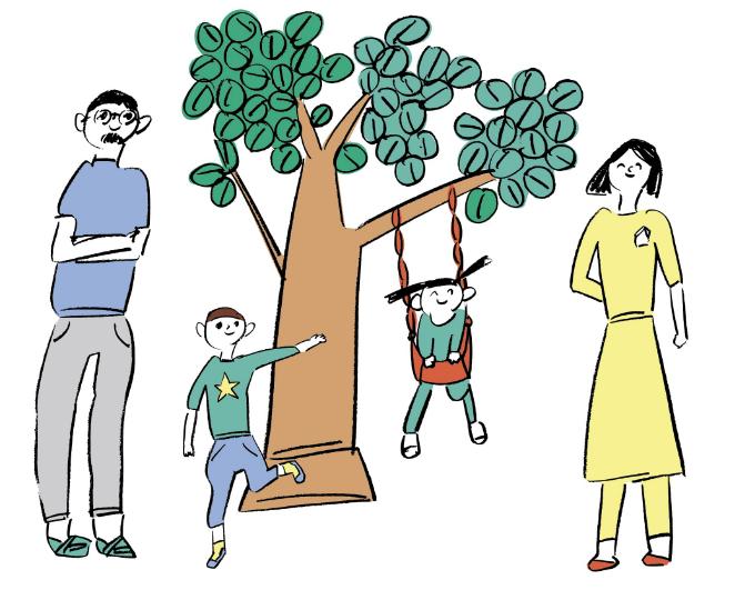 ブランコのあるシンボルツリーと家族
