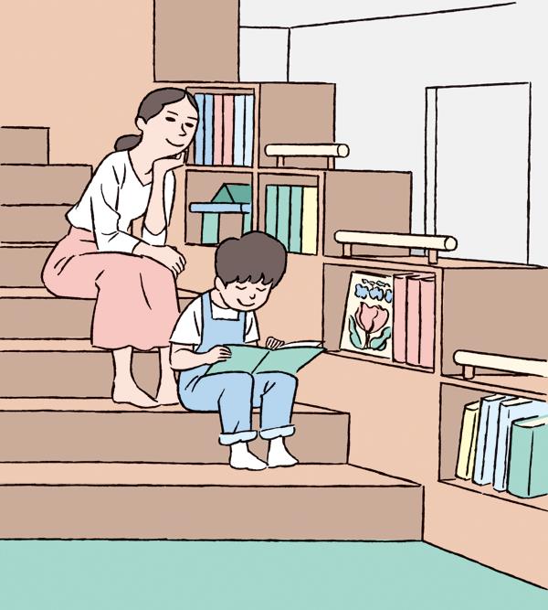 階段に座り本を読む親子