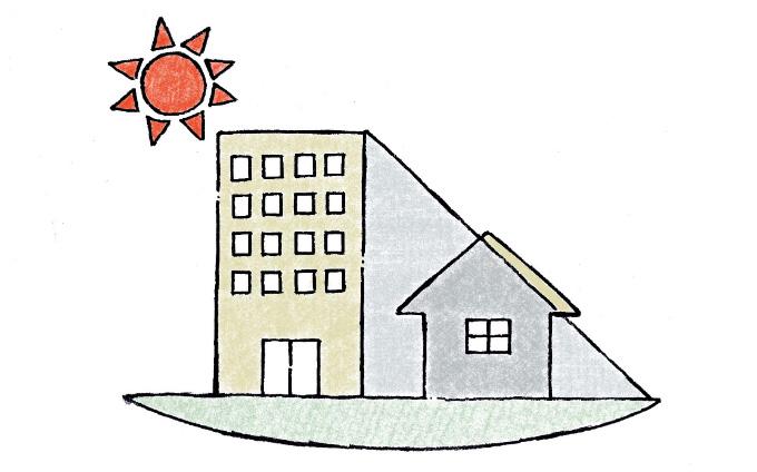 ビルが住宅の日差しを遮っているイラスト