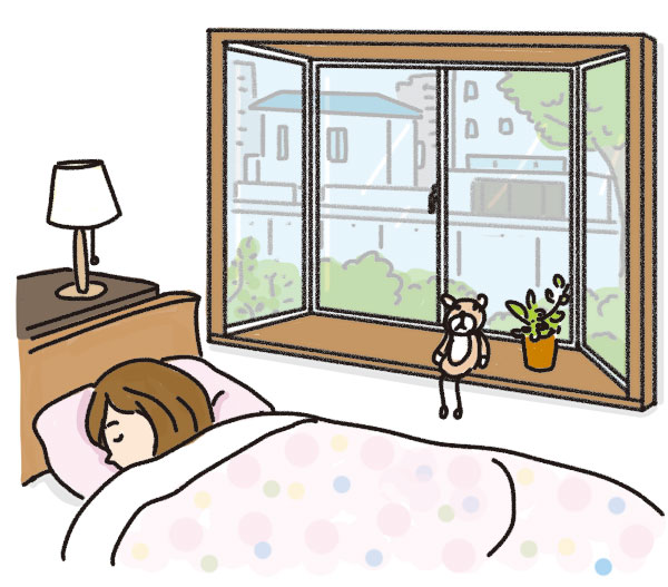 出窓のある部屋で眠る女性