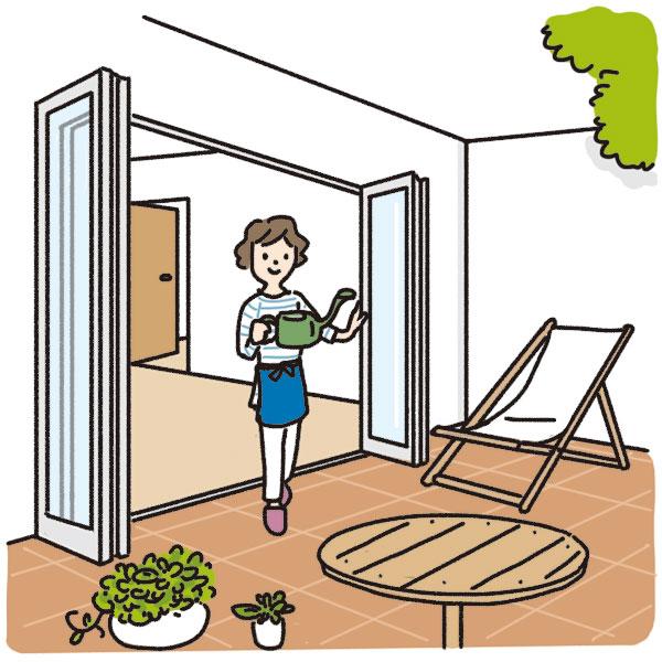 全開口窓(フルオープン窓)を開けテラスに出ている女性
