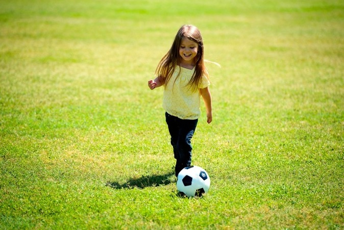 girl-playing-soccer-ball-happy-fun-child-kid