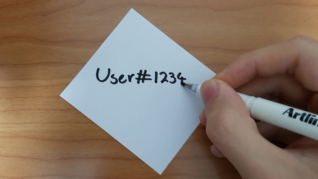 """""""User#1234"""" (a Discord username and discriminator) written on a piece of paper."""