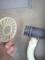Washer (10):排水溝の蓋にホースを固定して洗濯機側は準備完了。