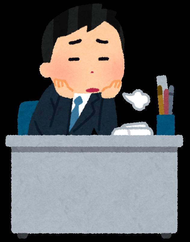 机でため息をつく男性社員
