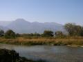 [風景・景観][空][河川]早春賦歌碑近くより、穂高川と有明山を望む(長野県安曇野市)