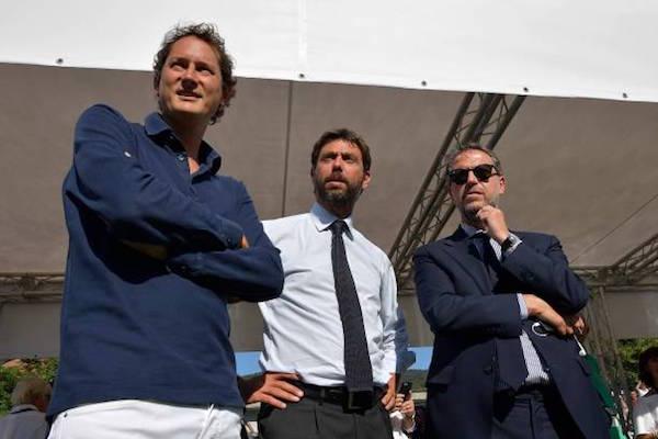 画像:EXORのトップも兼任するジョン・エルカン会長(写真・左)
