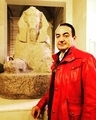 Mohamed Dekkak standing with sphinx Ver 1750 av. J. C. Paris France