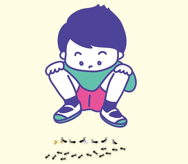 蟻の行列を見つめる少年