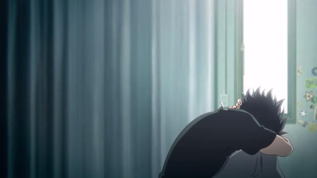 部屋で座り込み、首の後ろを抱える石田将也