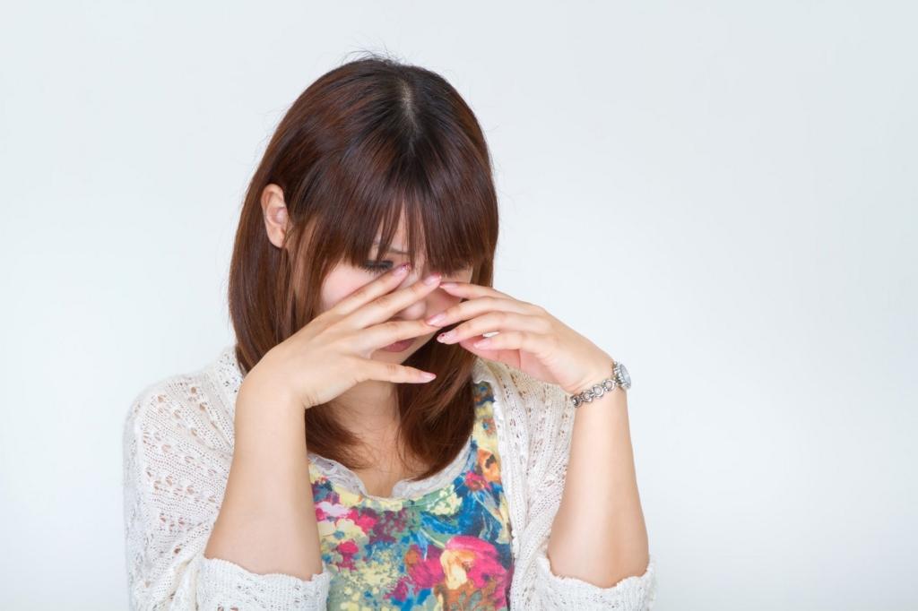 ルーティンでかかるストレスに悩む女性