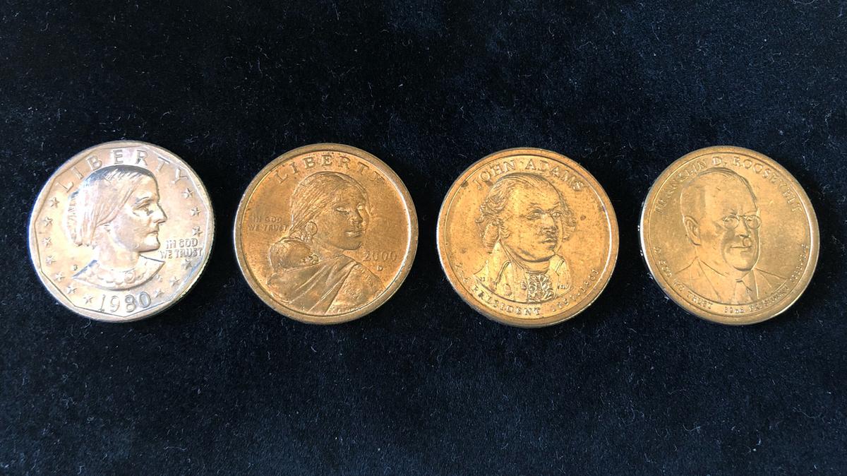 左から1980年、2000年、2007年、2014年発行の1ドルコイン