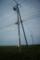 風車にかぶる電柱