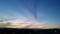 会社の便所の窓から夕焼けを見た。夜はこれから。長くなりそうだ。