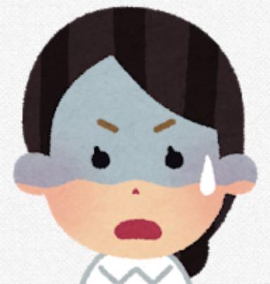 困った表情の女性