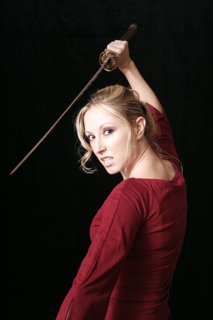 Beautiful  white woman brings a Japanese sword-katana close to a face Ⅲ. (日本刀を顔に近づける美しい白人女性 其の三)