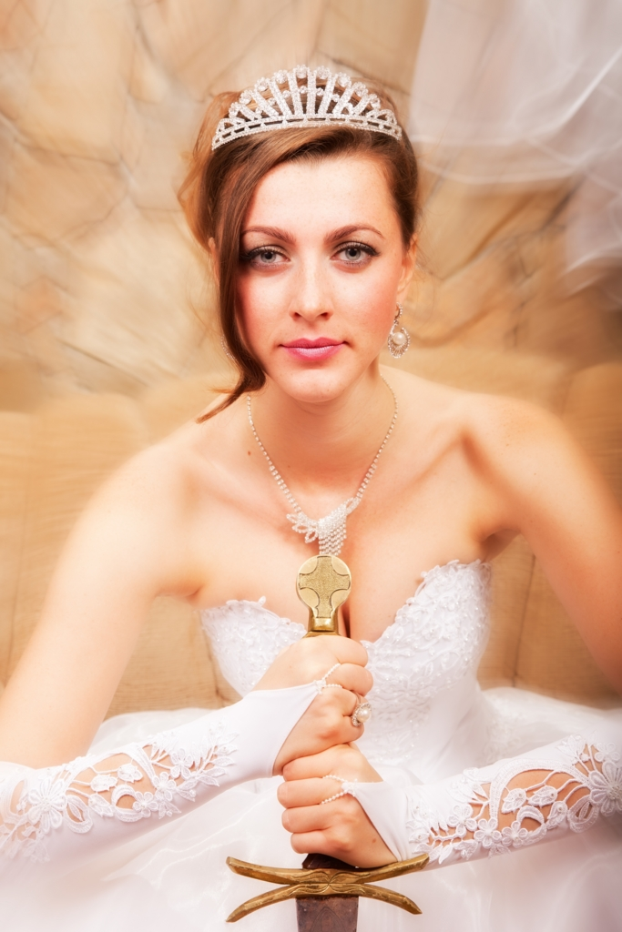 Beautiful white woman wears wedding dress with European sword.(剣を手にした花嫁衣装姿の美しい白人女性)