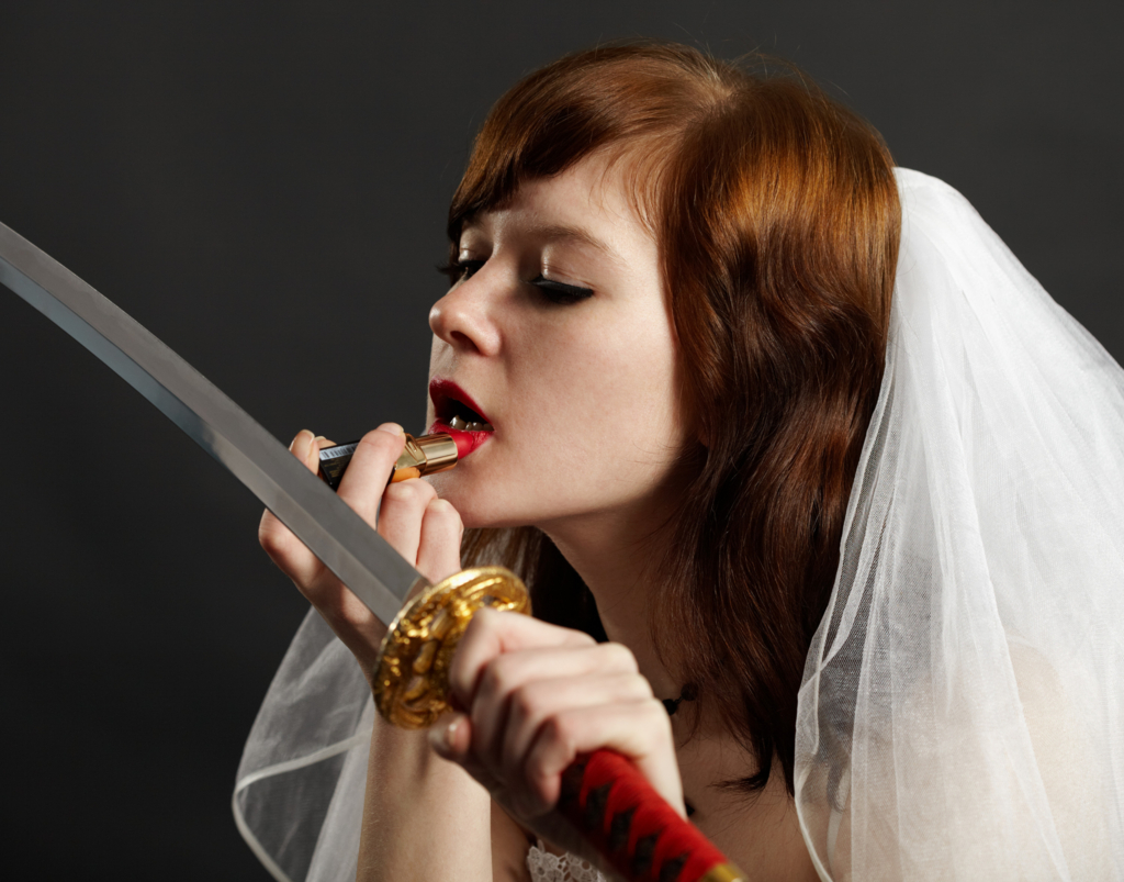 Beautiful white woman  painting a lipstick using a japanese sword-katana instead of a mirror in bridal dress Ⅰ.(日本刀を鏡代わりに口紅を塗る美しい白人女性の花嫁 其の一)