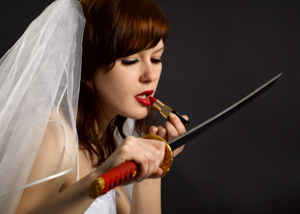 Beautiful white woman  painting a lipstick using a japanese sword-katana instead of a mirror in bridal dress Ⅱ.(日本刀を鏡代わりに口紅を塗る美しい白人女性の花嫁 其の二)