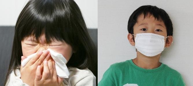 鼻をかむ女の子とマスクをする男の子
