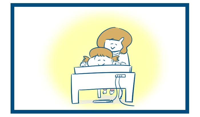 電子ピアノが届いて大喜びの妻と娘