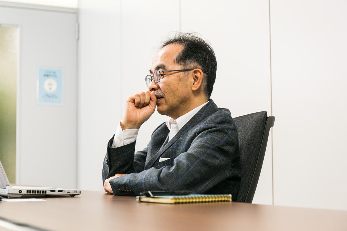 PostGreSQL石井達夫さん横顔2