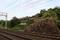 桜御門跡と五軒屋敷池の間を走る近鉄橿原線