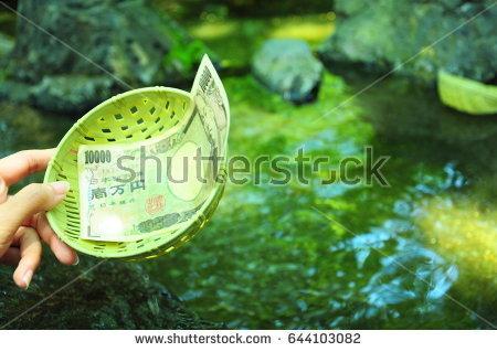stock-photo-money-washing-sarasvati-in-enoshima-japan-644103082.jpg