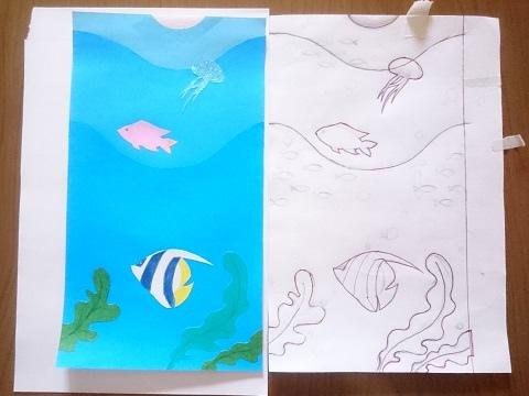 魚の絵を切り抜いて土台の紙に貼る