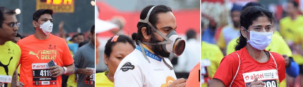 デリーハーフマラソンで大気汚染の中マスクを着用して走る人たち