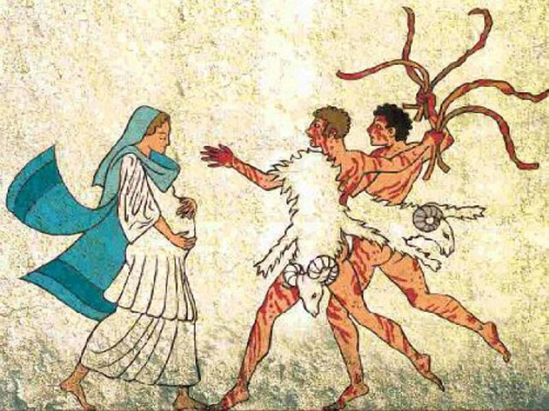 妊婦の女性とムチを手に持った流血系全裸男性2人組(ルペルカリア祭)