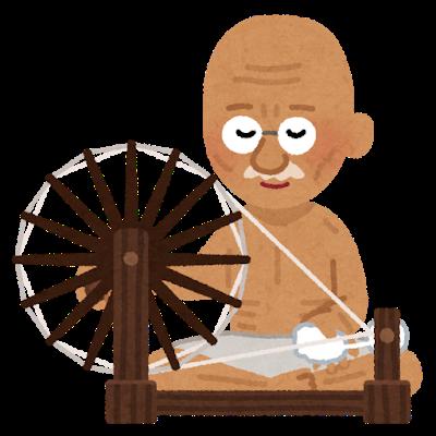 糸車で綿を紡ぐガンディー