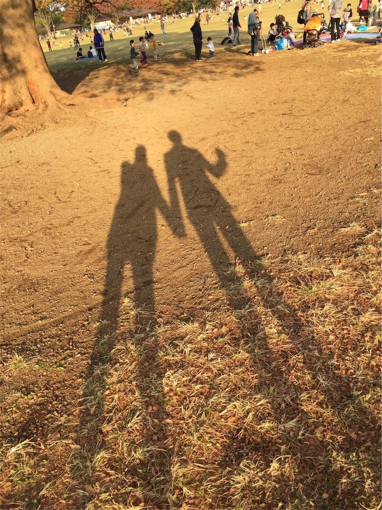 夕日 二人の影